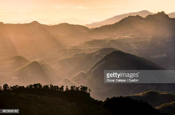 scenic view of mountains against sky during sunset - honduras stock pictures, royalty-free photos & images