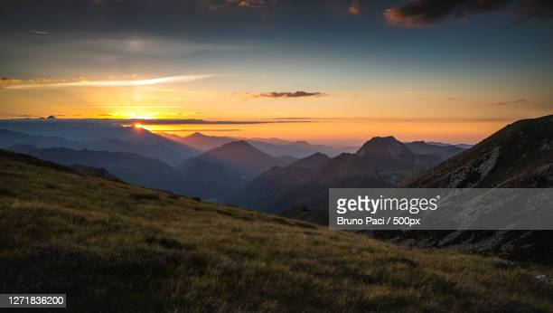 scenic view of mountains against sky during sunset, tarascon-sur-arige, france - アリエージュ ストックフォトと画像
