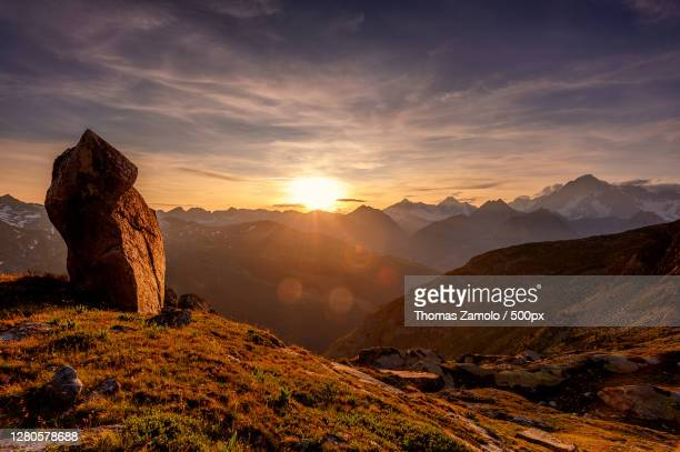 scenic view of mountains against sky during sunset,la thuile,aosta valley,italy - la thuile foto e immagini stock