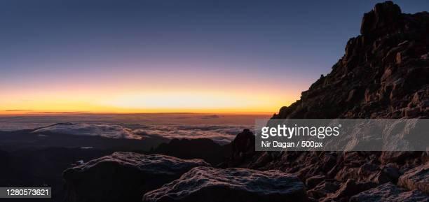 scenic view of mountains against sky during sunset,meru county,kenya - meru filme stock-fotos und bilder