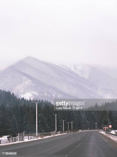 scenic view of mountains against sky during winter - lutai razvan stock pictures, royalty-free photos & images