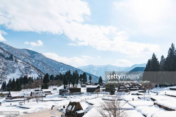 scenic view of mountains against sky during winter - 富山県 ストックフォトと画像