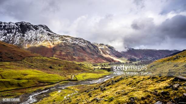 scenic view of mountains against sky during winter - ambleside stock photos and pictures