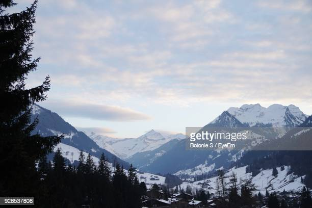 scenic view of mountains against sky during winter - gstaad stock pictures, royalty-free photos & images