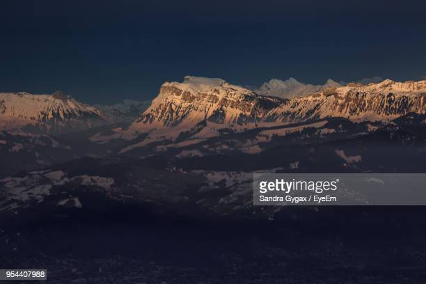 scenic view of mountains against sky during winter - sandra gygax stock-fotos und bilder