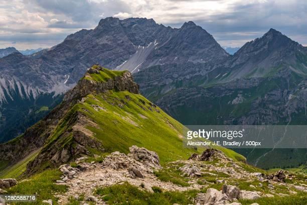 scenic view of mountains against sky, malbun, liechtenstein - liechtenstein stockfoto's en -beelden