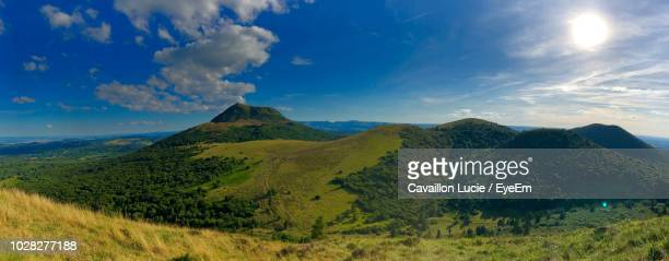 scenic view of mountains against sky - auvergne stock pictures, royalty-free photos & images