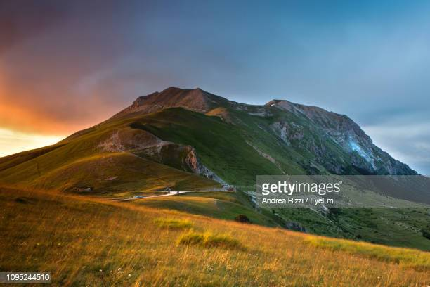 scenic view of mountains against sky - andrea rizzi stock pictures, royalty-free photos & images