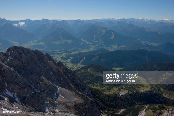 scenic view of mountains against sky - weiß stock pictures, royalty-free photos & images