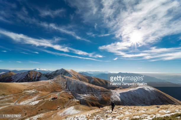 scenic view of mountains against sky - fabrizio zampetti foto e immagini stock