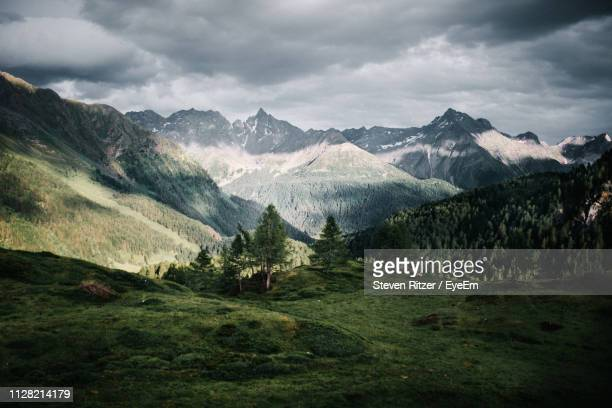 scenic view of mountains against sky - switzerland stock pictures, royalty-free photos & images