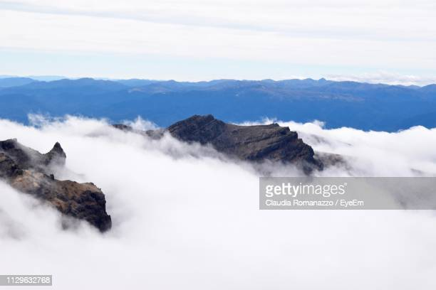 scenic view of mountains against sky - claudia romanazzo foto e immagini stock