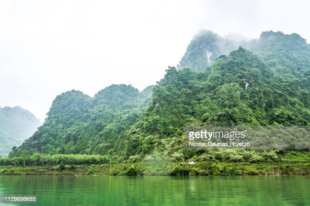 scenic view of mountains against sky - phong nha kẻ bàng national park stock photos and pictures