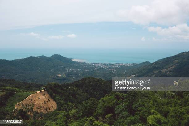 scenic view of mountains against sky - bortes cristian stock-fotos und bilder