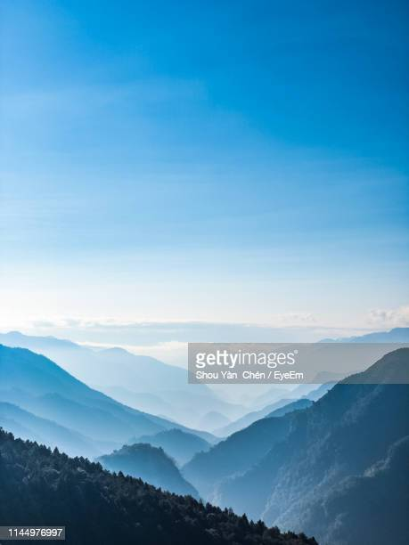 scenic view of mountains against sky - 山岳地帯 ストックフォトと画像