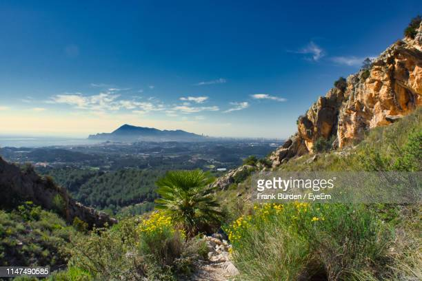 scenic view of mountains against sky - altea stock photos and pictures