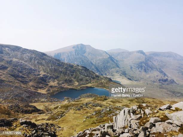 scenic view of mountains against sky - harriet stock photos and pictures