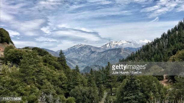 scenic view of mountains against sky - mount baldy stock photos and pictures
