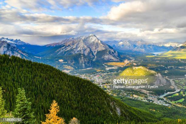 scenic view of mountains against sky - sulphur mountain stock pictures, royalty-free photos & images