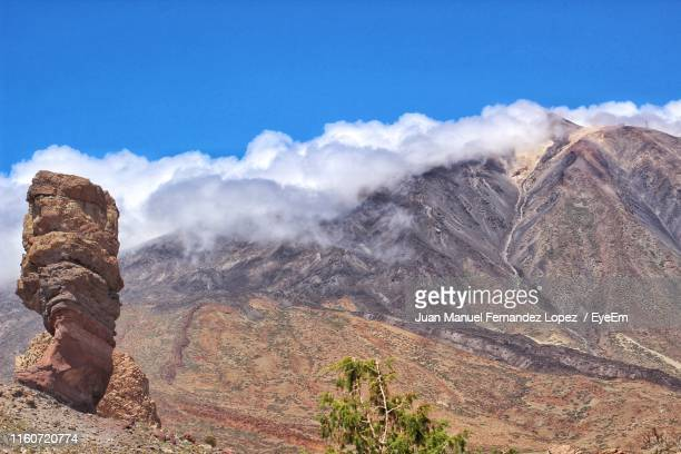 scenic view of mountains against sky - el teide national park stock pictures, royalty-free photos & images