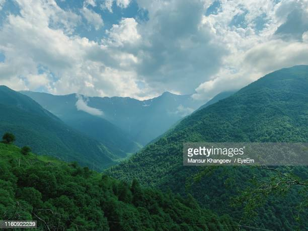 scenic view of mountains against sky - chechnya stock pictures, royalty-free photos & images