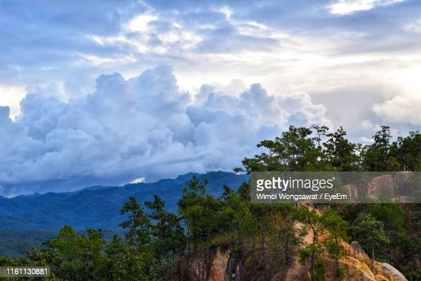 scenic view of mountains against sky - wimol wongsawat stock photos and pictures