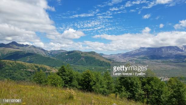 scenic view of mountains against sky - leren stock pictures, royalty-free photos & images