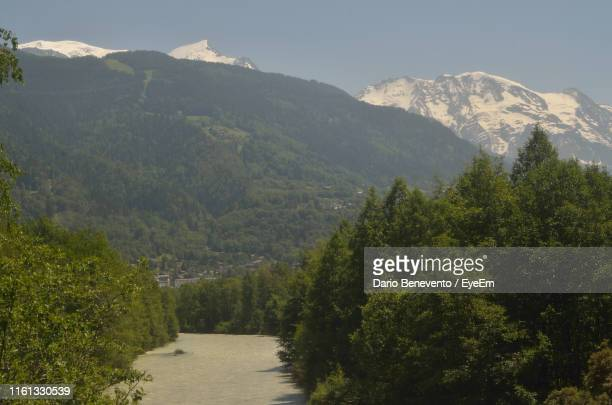 scenic view of mountains against sky - sallanches stock pictures, royalty-free photos & images