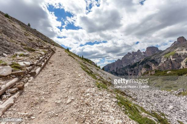 scenic view of mountains against sky - steep stock pictures, royalty-free photos & images