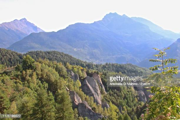 scenic view of mountains against sky - antonella di martino foto e immagini stock