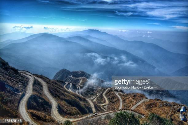 scenic view of mountains against sky - sikkim stock pictures, royalty-free photos & images