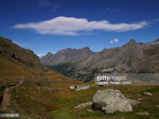 scenic view of mountains against sky - loredana perugini stock pictures, royalty-free photos & images
