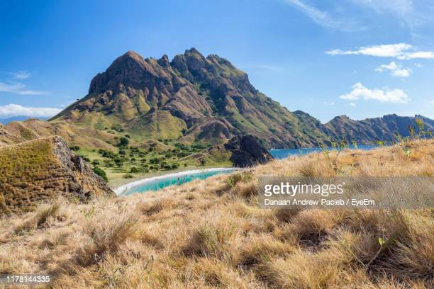 scenic view of mountains against sky - komodo dragon stock pictures, royalty-free photos & images