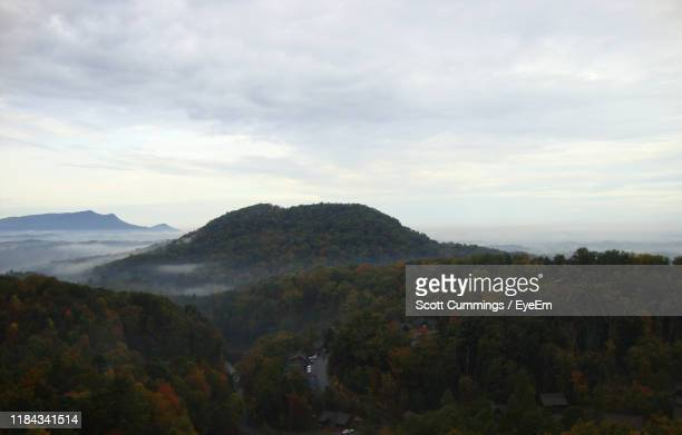 scenic view of mountains against sky - pigeon forge stock pictures, royalty-free photos & images