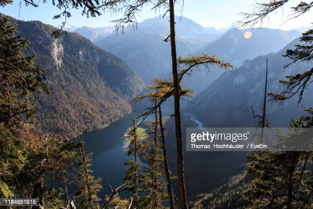 scenic view of mountains against sky - oberbayern stock-fotos und bilder