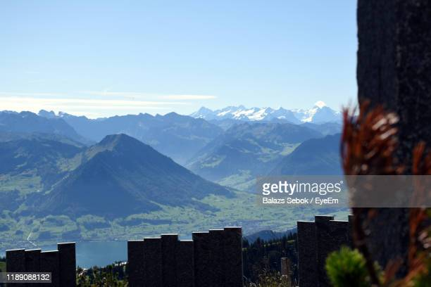 scenic view of mountains against sky - schwyz stock pictures, royalty-free photos & images