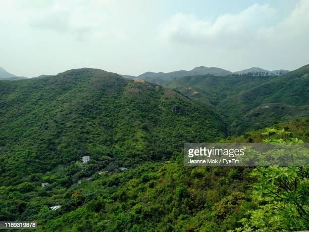 scenic view of mountains against sky - ceremony stock pictures, royalty-free photos & images