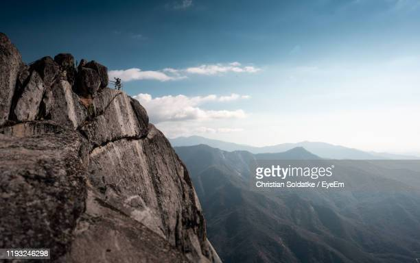 scenic view of mountains against sky - christian soldatke stock pictures, royalty-free photos & images