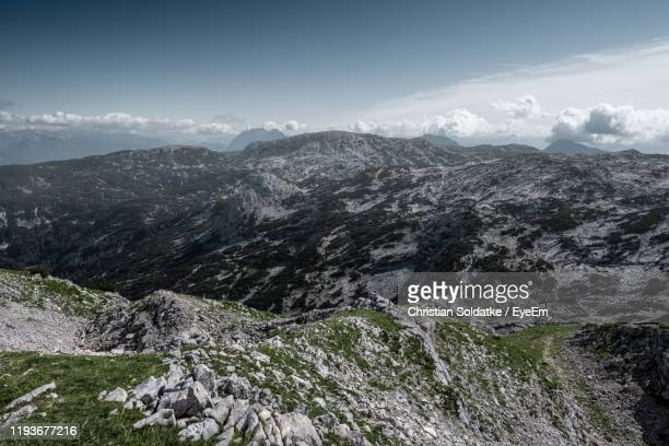 scenic view of mountains against sky - christian soldatke stock-fotos und bilder