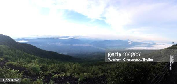 scenic view of mountains against sky - panaikorn chutidaralux stock photos and pictures