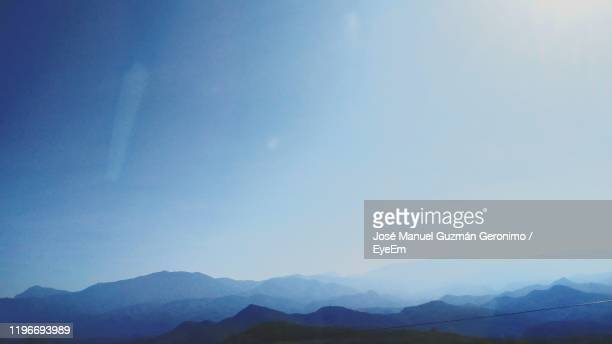 scenic view of mountains against sky - geronimo foto e immagini stock