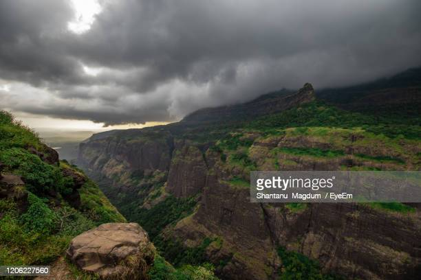 scenic view of mountains against sky - rainy season stock pictures, royalty-free photos & images