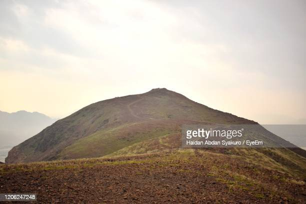 scenic view of mountains against sky - volcanic landscape stock pictures, royalty-free photos & images