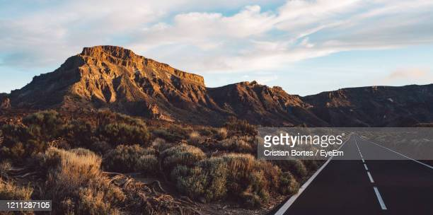 scenic view of mountains against sky - bortes stock pictures, royalty-free photos & images
