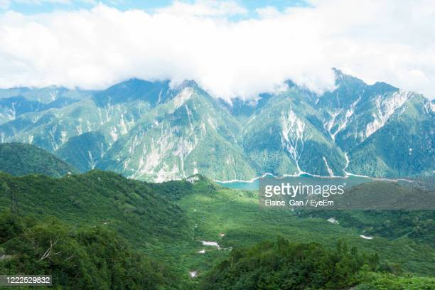 scenic view of mountains against sky - 富山県 ストックフォトと画像