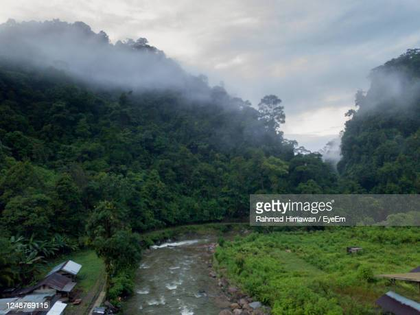 scenic view of mountains against sky - rahmad himawan stock pictures, royalty-free photos & images