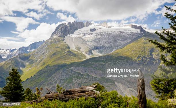 scenic view of mountains against sky - sandra gygax stock-fotos und bilder