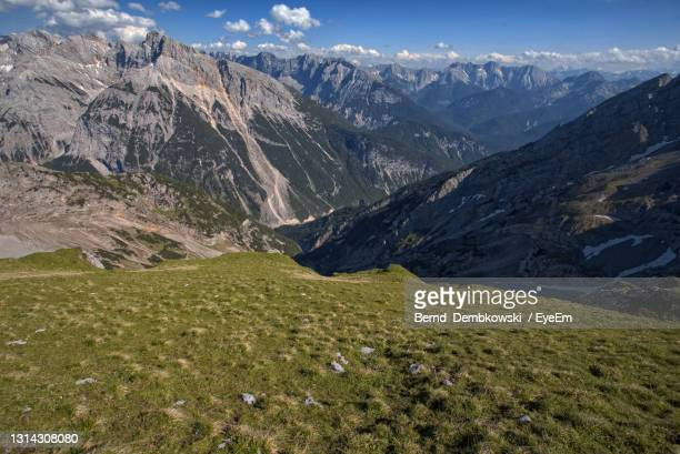 scenic view of mountains against sky - mittenwald stock pictures, royalty-free photos & images