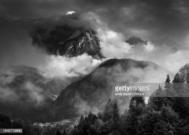 scenic view of mountains against sky - andy dauer stock pictures, royalty-free photos & images