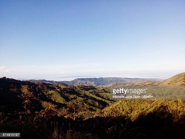 scenic view of mountains against sky - davao city stock photos and pictures